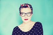 Cute pin up woman wearing glasses
