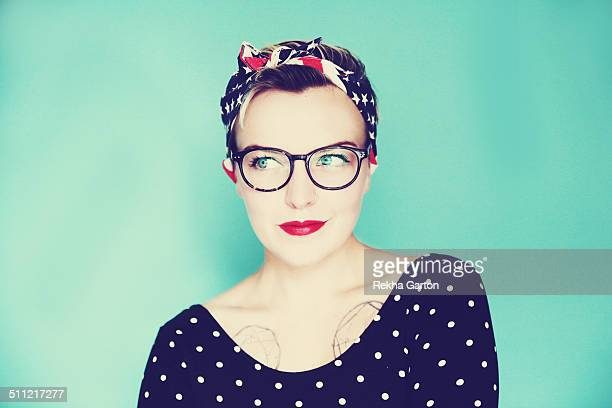 Cute pin up woman wearing glasses