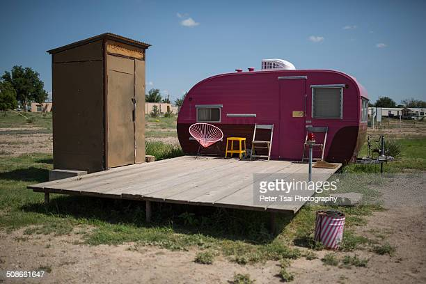 Cute pink camping trailer with an outdoor bathroom at El Cosmico in Marfa TX in 2014
