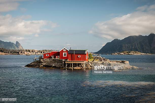 Cute red cottage on tiny island