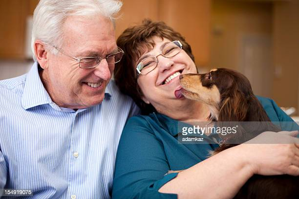 Cute Senior Couple Smiling with Puppy