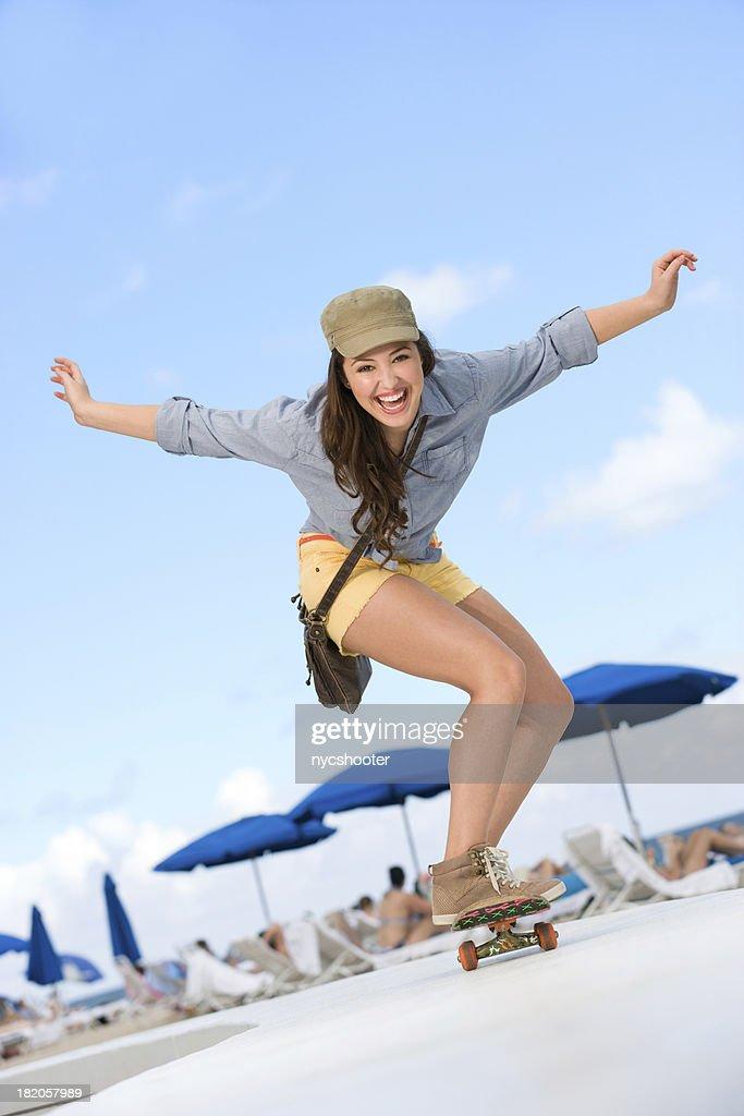 Cute Skater girl skateboarding