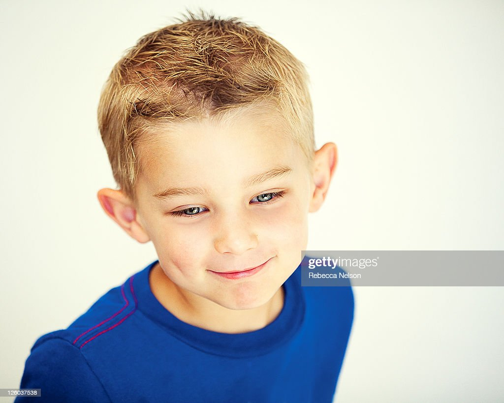 Cute smiling little boy on white background : Stock Photo