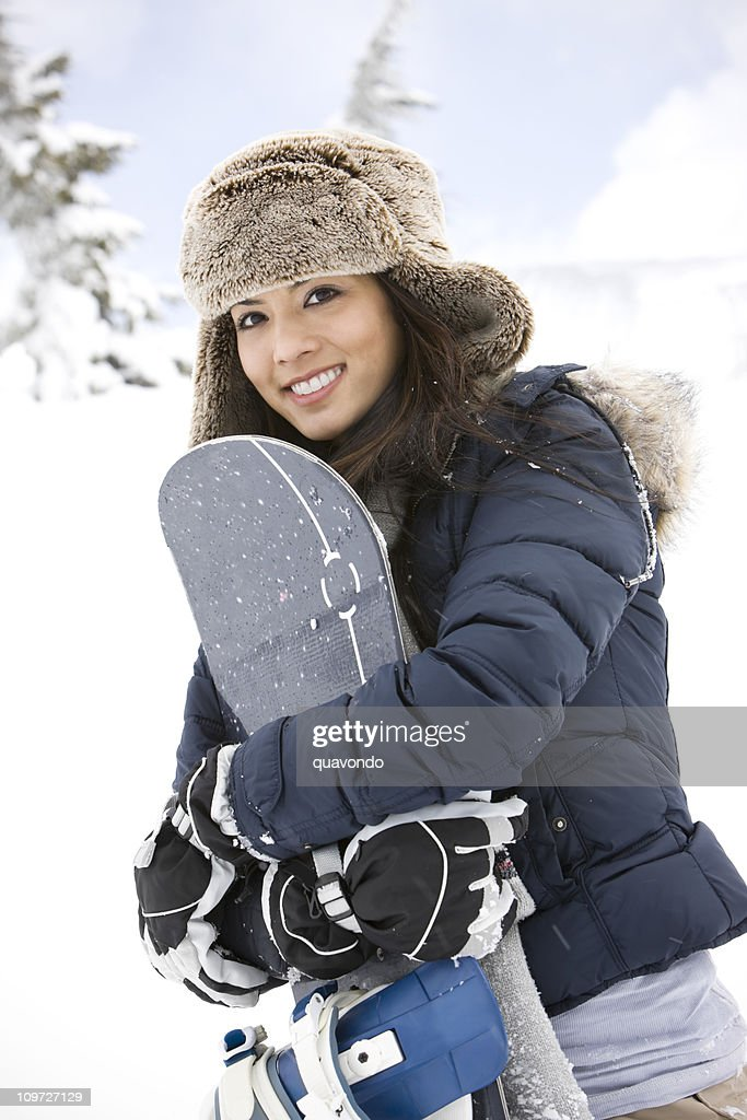 Cute Smiling Young Girl Holding Snowboard on Mountain : Stock Photo