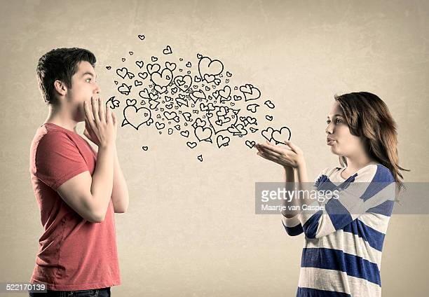 Cute Teenage couple - Blowing kisses/hearts