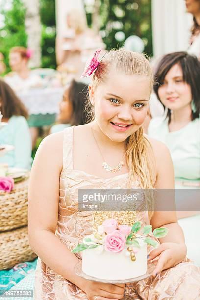 Cute teenage girl at a garden party