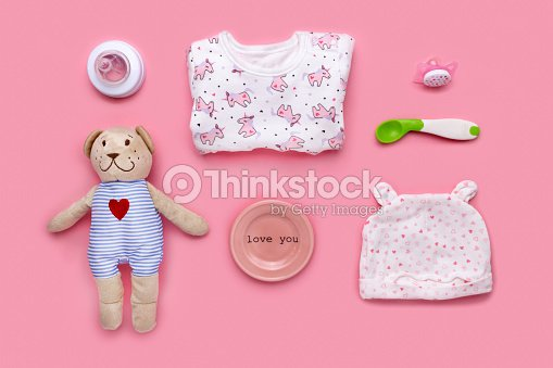 Cute toddler (girl) accessories on a pink background shot knolling style : Stock Photo