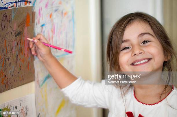 Cute Turkish girl drawing