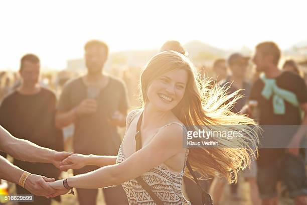 Cute woman dancing at outside festival