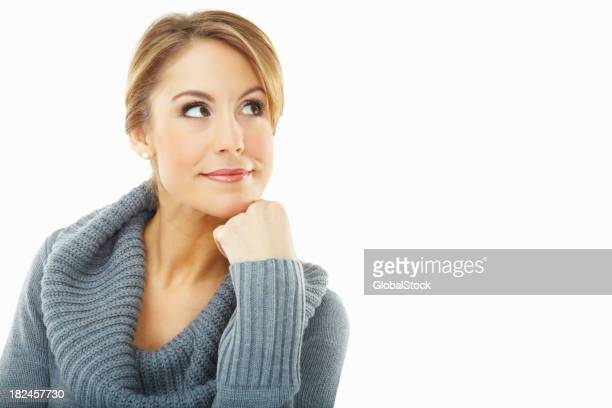 Cute woman in winter wear looking at copyspace