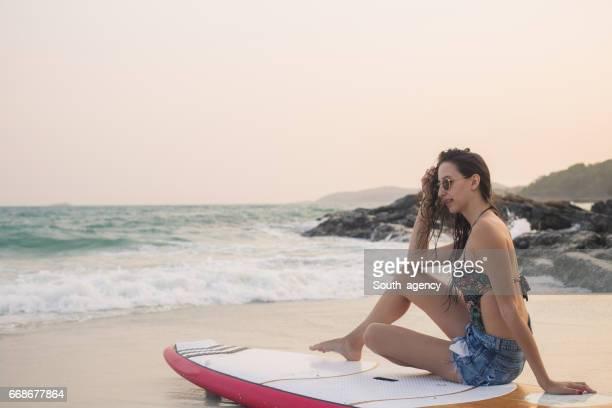 Cute woman surfer