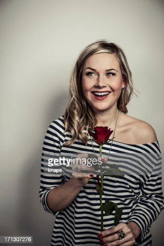 Cute woman with a red rose