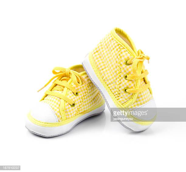 Cute yellow baby shoes with laces