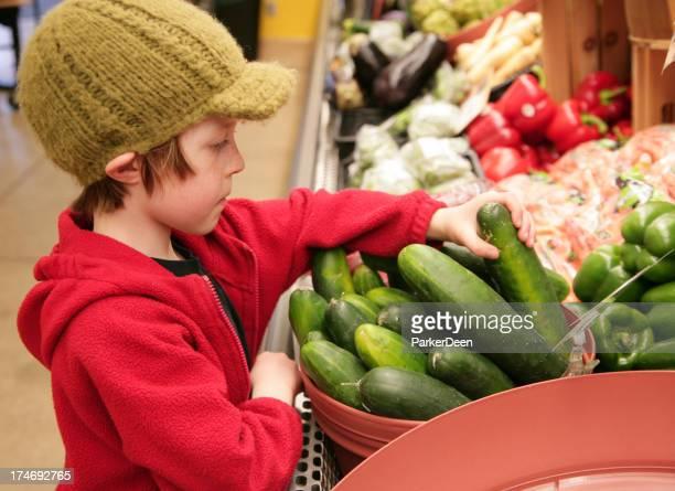 Cute Young Boy Choosing Organic Vegetables