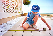 cute young boy, kid halps father with renovation of rooftop patio zone
