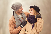 Cute young couple enjoying the cold weather outdoors.