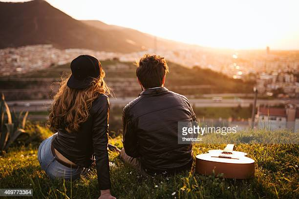 Cute young couple looking sunset