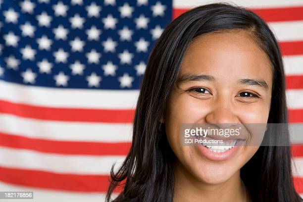 Cute Young Hispanic Girl in Front of American Flag