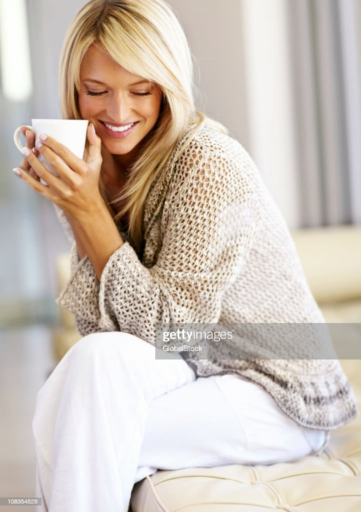Cute young lady with a cup of coffee : Stock Photo