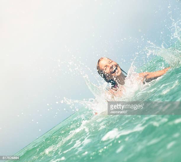 Cute young woman enjoying in the sea