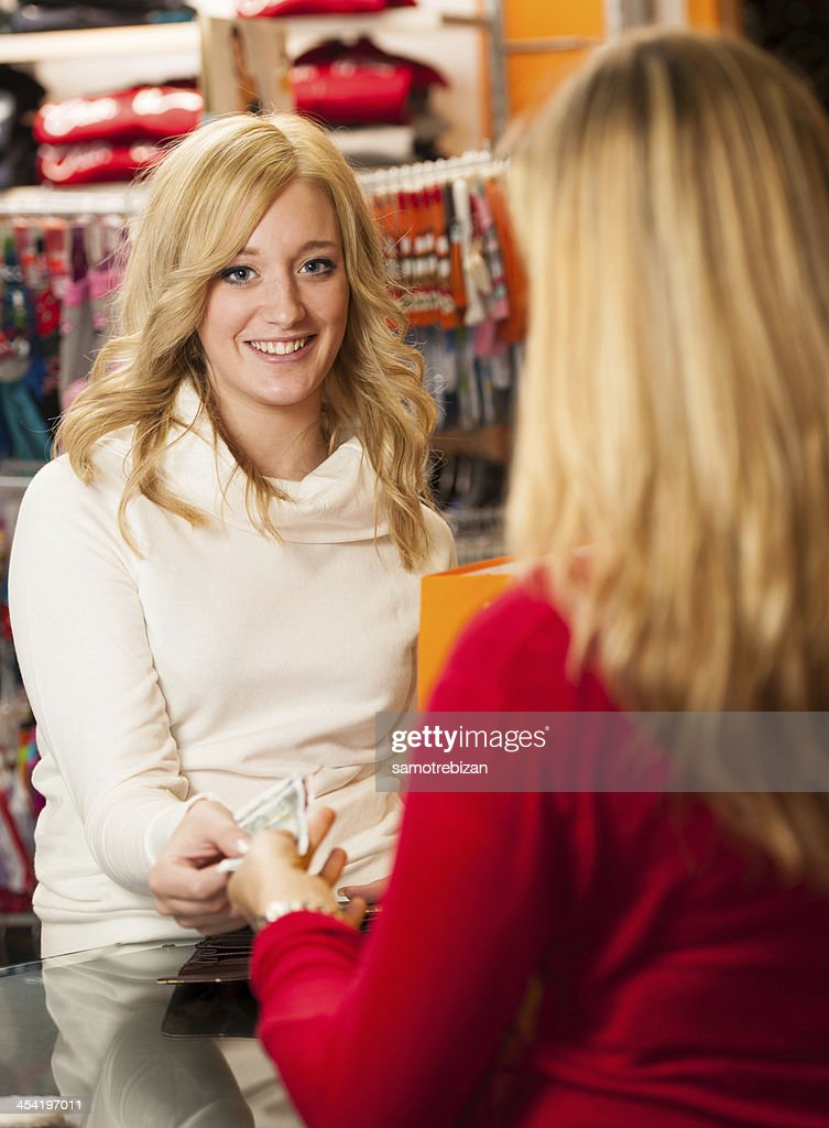Cute young woman paying after succesfull purchase with credit card : Stock Photo