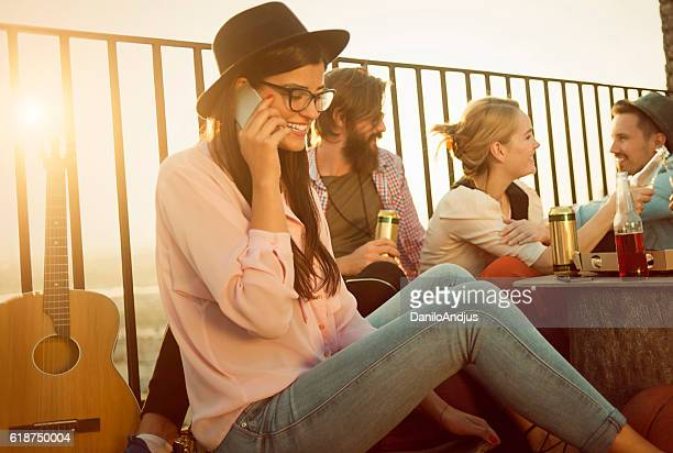 cute young woman talking on her smartphone