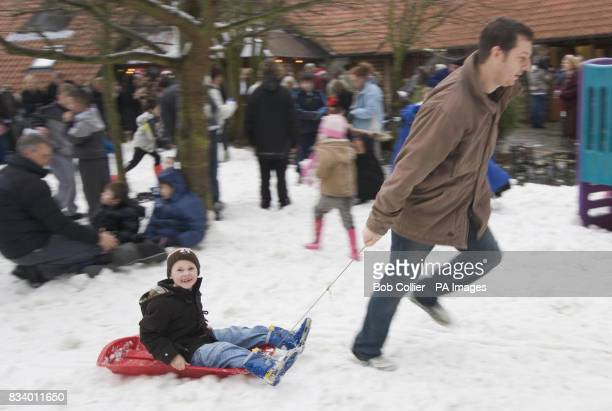 Cutiss Finister and his father Ashley enjoy the snow at Martin House children's hospice near Leeds after local businessman Chris Hopkins won a...