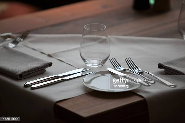 Cutlery serviettes a glass and a side plate sit on a dining table in the summit restaurant inside the Schloss Elmau hotel ahead of the Group of Seven...