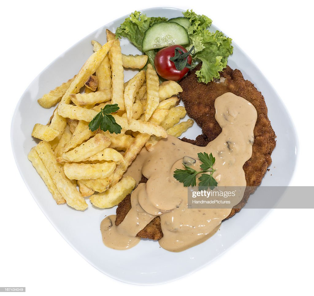 Cutlet with Chips on white : Stock Photo
