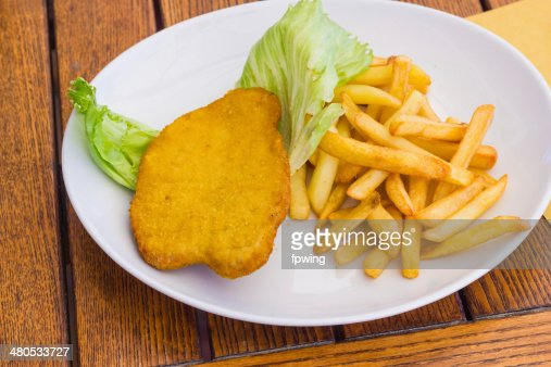 Cutlet with chips : Stock Photo
