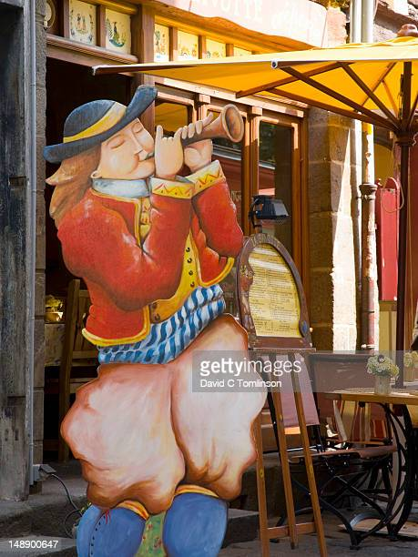 Cut-out figure of horn blower outside Creperie La Gavotte in Rue Saint-Georges.