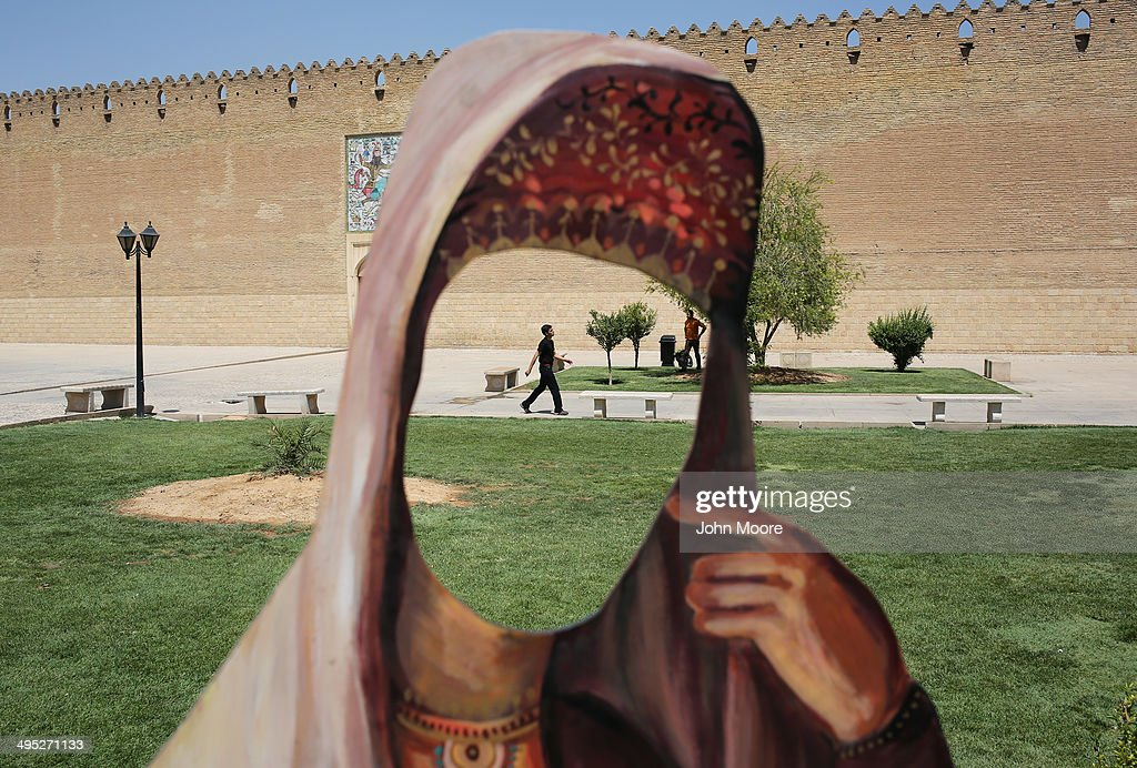 A cutout of a woman in Iranian dress stands in front of the Karim Khani Palace, also a former prison, on May 29, 2014 in Shiraz, Iran. Shiraz, celebrated for more than 2,000 years as the heartland of Persian culture, is known as the home of Iranian poetry and for its progressive attitudes and tolerance. Like all of Iran, this week Shiraz observes the 25th anniversary of the death and continued legacy of the Ayatollah Khomeini, the father of the Islamic revolution.