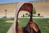 A cutout of a woman in Iranian dress stands in front of the Karim Khani Palace also a former prison on May 29 2014 in Shiraz Iran Shiraz celebrated...