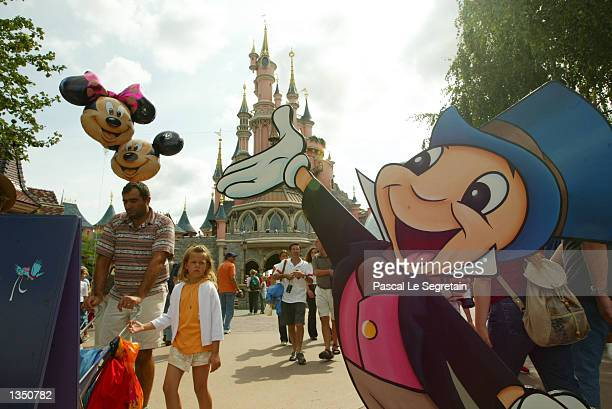A cutout of Jiminy Cricket welcomes visitors to Fantasyland in Disneyland Paris is shown August 22 2002 in Marne la Vallee France After a rocky start...