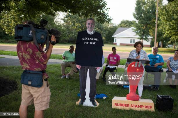 A cutout of Rep Brian Fitzpatrick RPa appears at protest outside of his town hall meeting in Bensalem Pa on August 22 2017