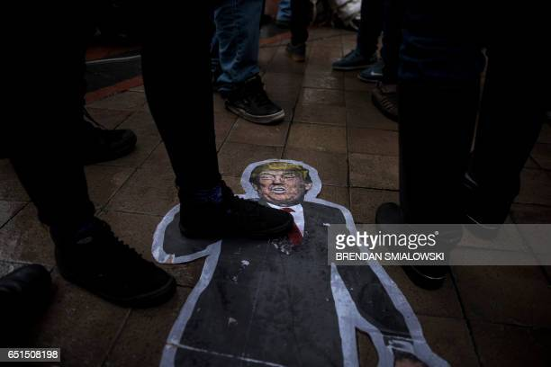 A cutout of US President Donald Trump is seen on the ground as activists rally in front of the Trump International Hotel to protest the Dakota...