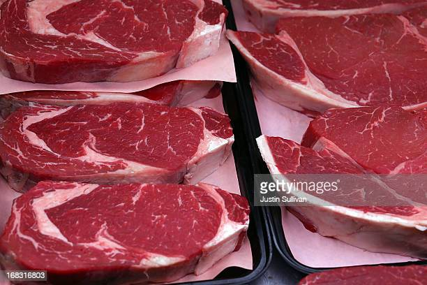 Cuts of beef are displayed at Woodlands Meats on May 8 2013 in Kentfield California With US cattle and calf herds at their lowest levels since 1952...