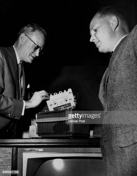 Cuts Tape for 1962 Ward terry left president of Ward terry and Co RCA Victor wholesale dealer shows one of the new tape recorders featuring a...