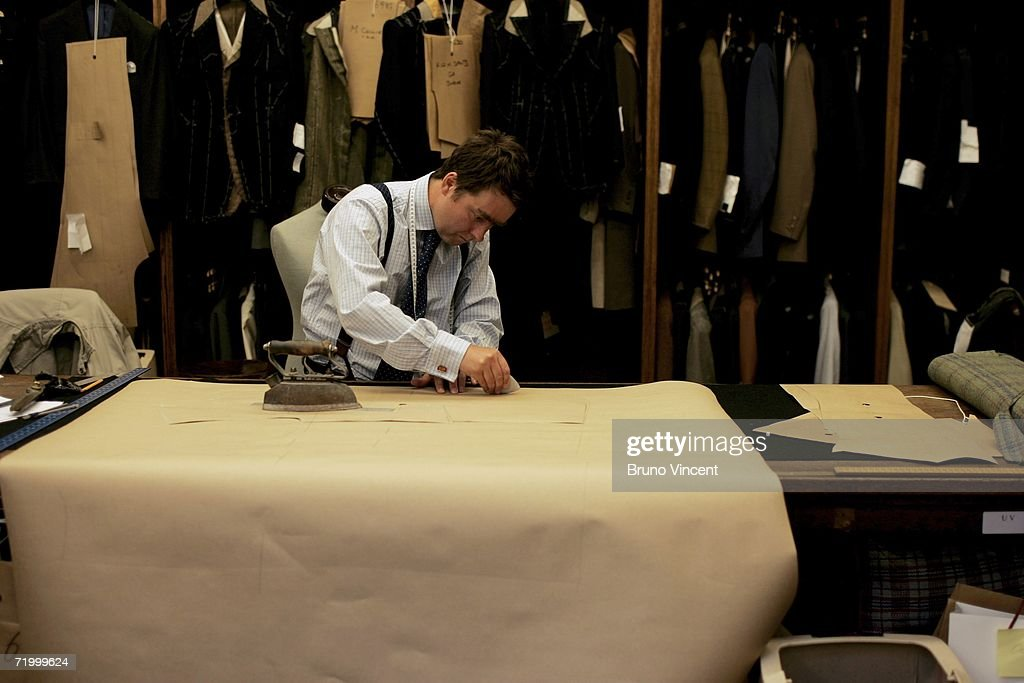 A cutter marks out a pattern in Huntsman tailors on August 14, 2006 in London, England. With the commercial expansion of nearby tourist shopping areas, high street stores have become the main competitors to the traditional bespoke tailoring of Savile Row. Following uncertainty about the future of the bastion of English tailoring, Savile Row still maintains a reputation of excellence in the trade.