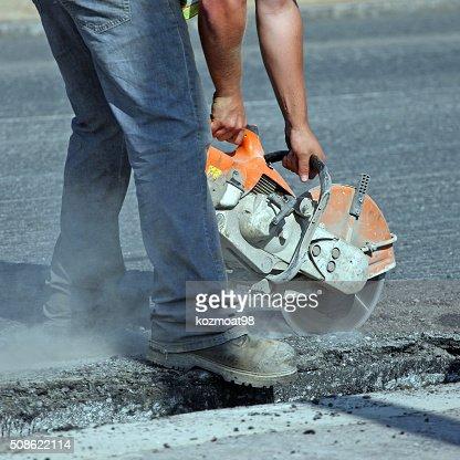 Cutting Asphalt Pavement On A Road Repair Site : Stock Photo