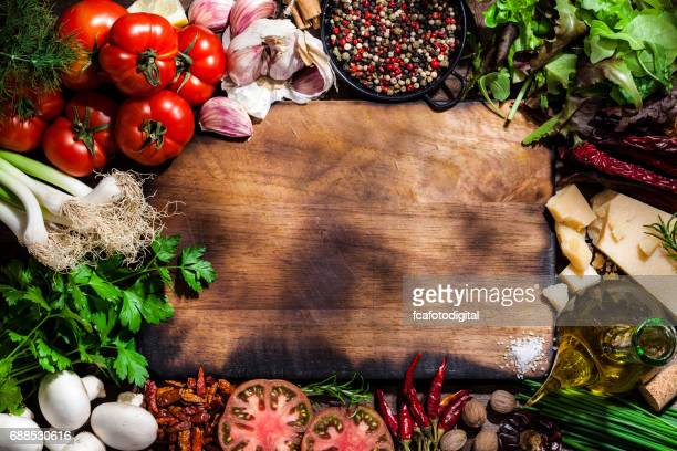 Cutting board with fresh ingredients for cooking and seasoning