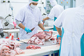 cutting meat slaughterhouse workers in the refrigerator