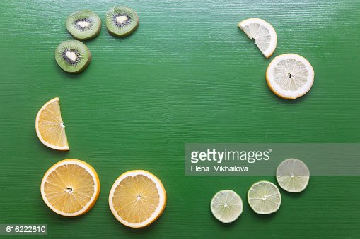 Cutting of fruit on a green background : Stock Photo
