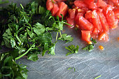 cutting parsley and tomato