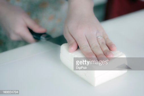 Cutting soybean curd with kitchen knife