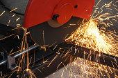 cutting steel with grinder machine close up