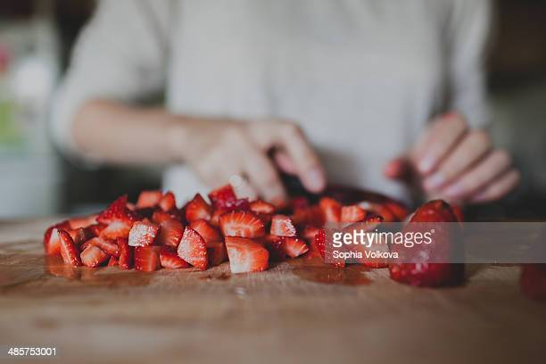 Cutting strawberries for jam