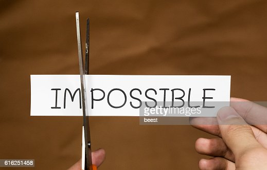 cutting the word impossible to possible : Foto de stock