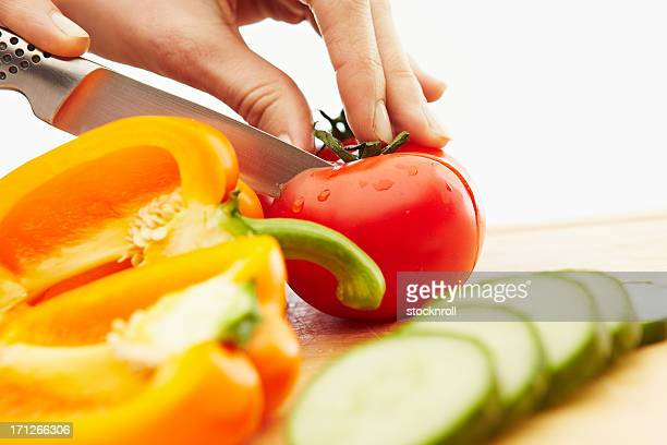 Cutting vegetables on a chopping board
