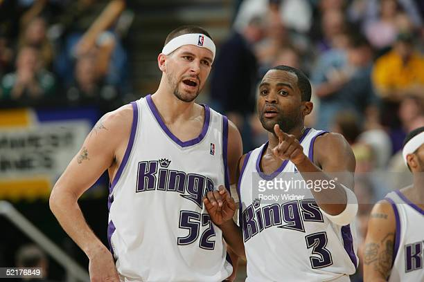 Cuttino Mobley and Brad Miller of the Sacramento Kings talk during the game against the Seattle SuperSonics on February 1 2005 at Arco Arena in...